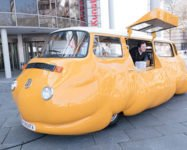 Hot Dog Bus giving away free hot dogs in Brooklyn Bridge Park all summer